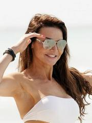 Lizzie Cundy in a sexy cutaway swimsuit