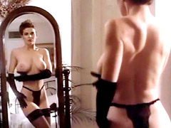 Shannon Whirry poses topless in black..