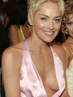 Sharon Stone showing breasts in a..