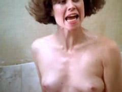 Sigourney Weaver topless washes by broken shower head in bath