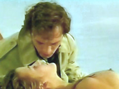 Sophie Marceau topless laying on towel..