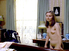 Tara Fitzgerald nude laying on bed and speaking on phone