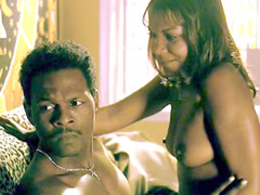 Ebony babe Tonia Murphy riding black guy on a couch
