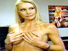Busty Torrie Wilson undresses fully..